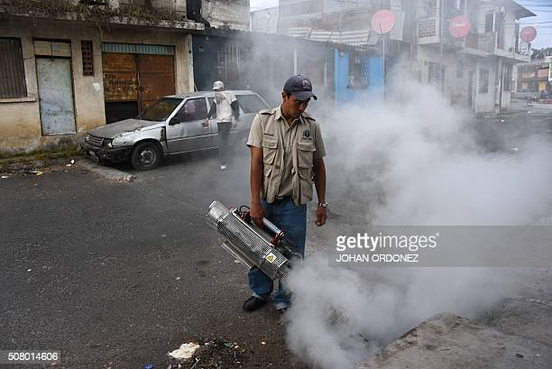 Health ministry workers fumigate against the Aedes aegypti mosquito vector of the dengue Zika and Chikungunya viruses in the Bethania neighborhood in...