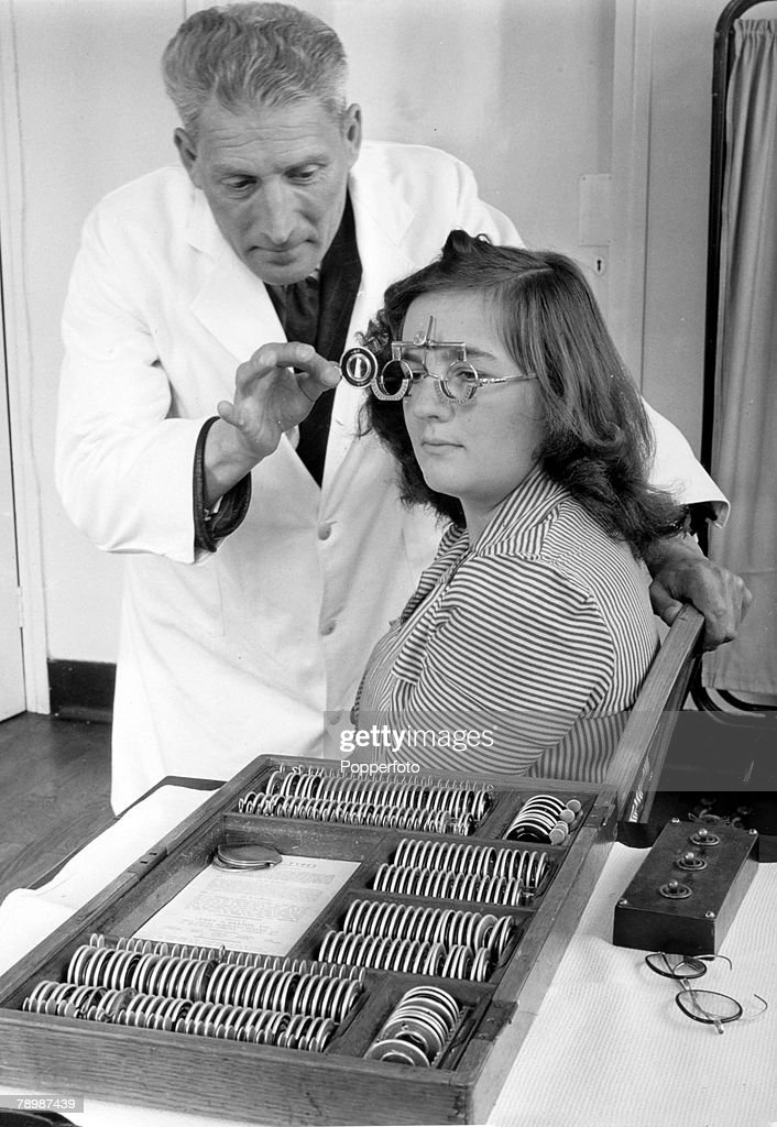 Health, National Health Service, Great Britain, pic: July 1948, An optician working at a Bristol clinic with a young woman having a eye test, under the new National Health Service system spectacles can be provide free of charge on a doctor's prescription, In the new system stylish 'fancy frames' are charged for