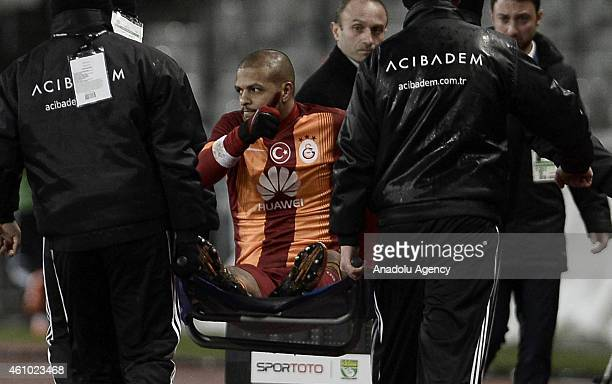 Health officers carry Felipe Melo of Galatasaray after his injury during the Turkish Spor Toto Super League soccer match between Besiktas and...