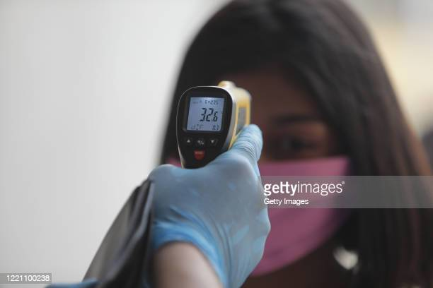 Health officers check temperature of spectators as they enter the Alexis Arguello Sports Center on April 25 2020 in Managua Nicaragua Nicaragua is...