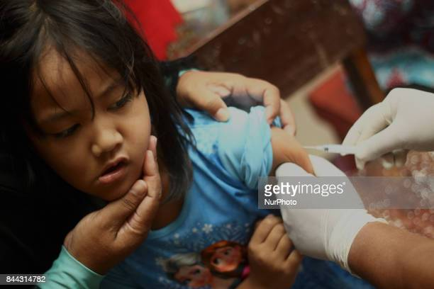 Health officers injected the Measles Rubella vaccine to children at an integrated health service post in Wanasari Village West Java on September 8...