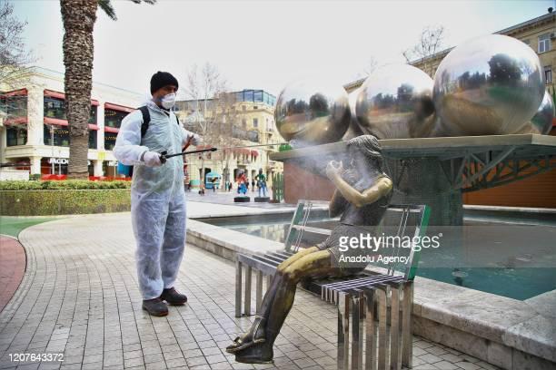 Health official disinfects streets as a precaution against coronavirus outbreak in Baku, Azerbaijan on March 19, 2020.