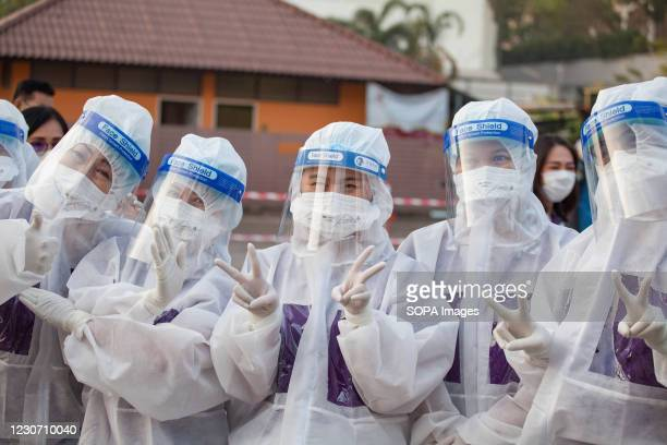 Health official pose for a photo during a saliva-based Covid-19 test at Bangkok Fish Marketing Organization during a Covid-19 screening and testing...