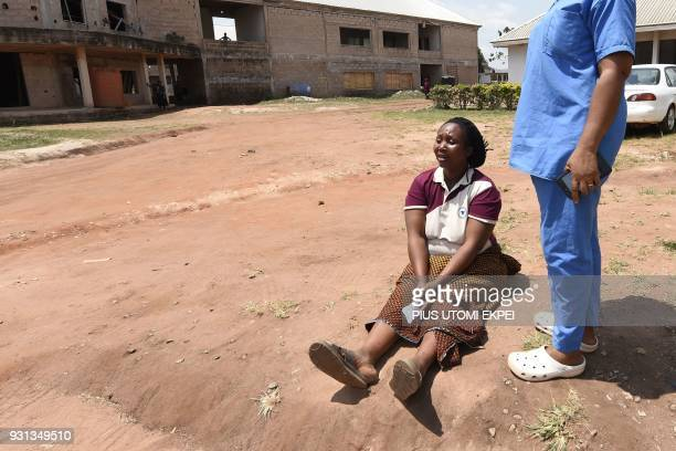 A health official tends to woman in tears at the Institute of Lassa Fever Research and Control in Irrua Specialist Teaching Hospital in Irrua Edo...