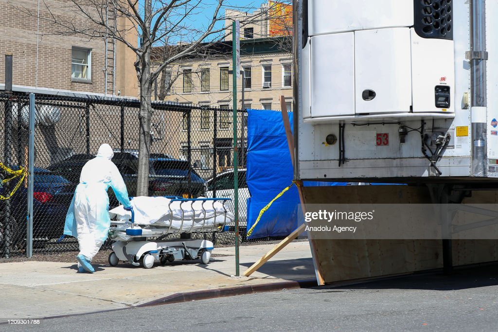 Caucasian Emergency Doctors Transporting Victim After
