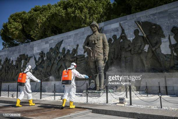 Health officials carry out disinfecting works at Martyrs' Memorial within the precautions against coronavirus in Gallipoli Peninsula of Canakkale...