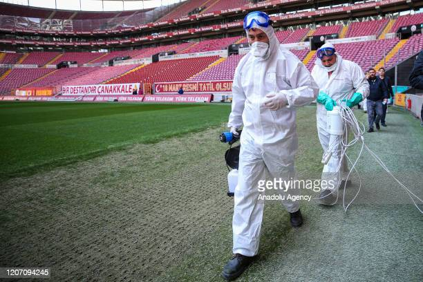 Health officials carry out disinfecting works at Turk Telekom Stadium within the precautions against coronavirus ahead of Turkish Super Lig derby...