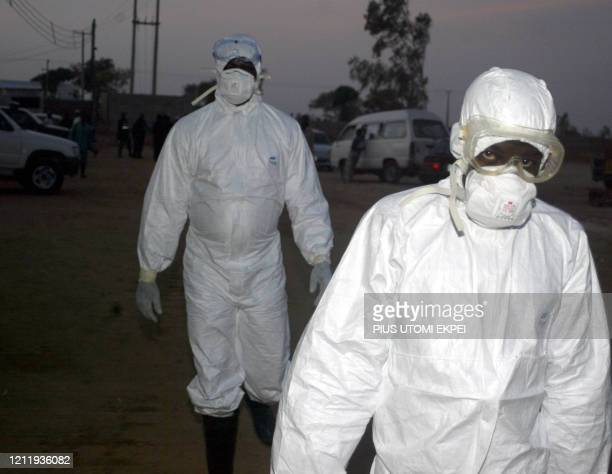 Health officials head to the dump site of 168 ostrich being killed by policemen 09 February 2006 at the Sambawa farms in Jaji district of Kaduna...
