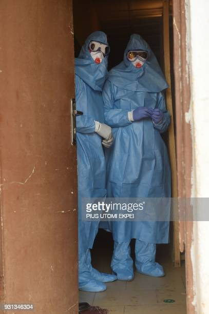 Health officials wear protective gear to tend to Lassa fever patients at the Institute of Lassa Fever Research and Control in Irrua Specialist...