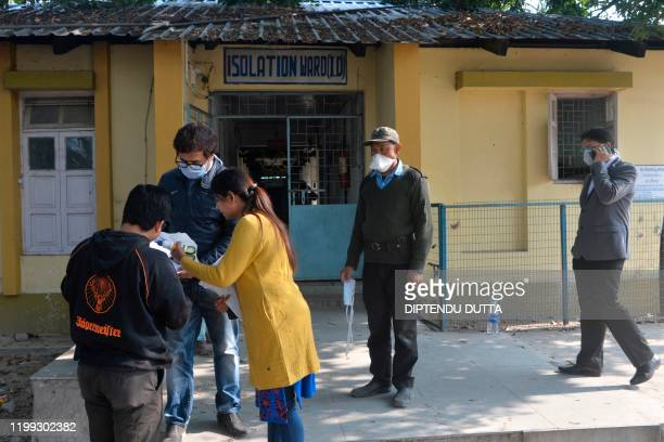 Health officials wearing protective facemasks stand inside an isolation ward opened as a preventative measure following a SARSlike virus outbreak...