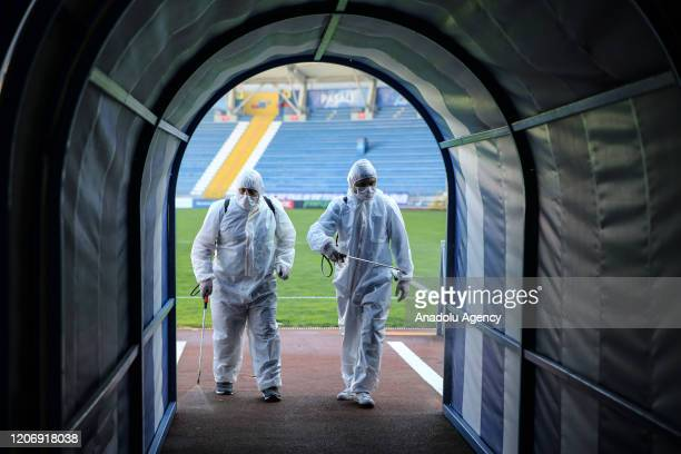 Health officials wearing protective suit disinfect Recep Tayyip Erdogan Stadium as a precaution to Coronavirus ahead of Turkish Super Lig soccer...
