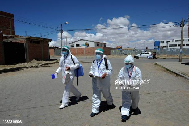 Health personnel of the Bolivian Health Ministry walk at Santa Rosa neighborhood to vaccinate people against COVID-19 home by home in El Alto,...