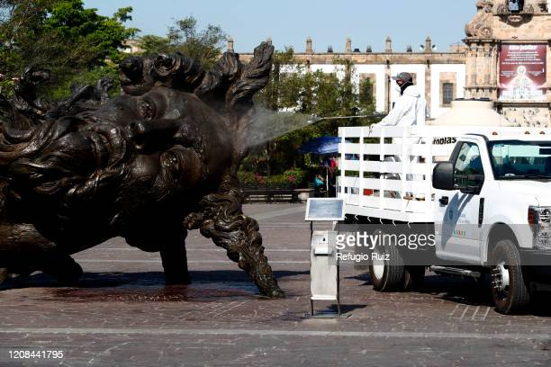 Health personnel sanitize the public spaces in Zapopan as part of the preventive measures against the spread of the COVID-19 on March 27, 2020 in...