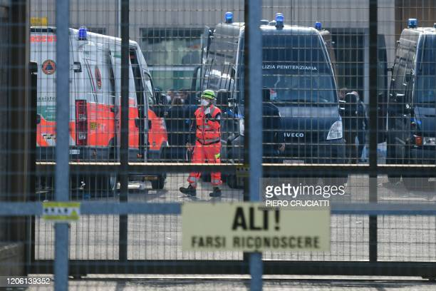 A health personnel wearing a respiratory mask walks across the SantAnna prison in Modena EmiliaRomagna in one of Italy's quarantine red zones on...