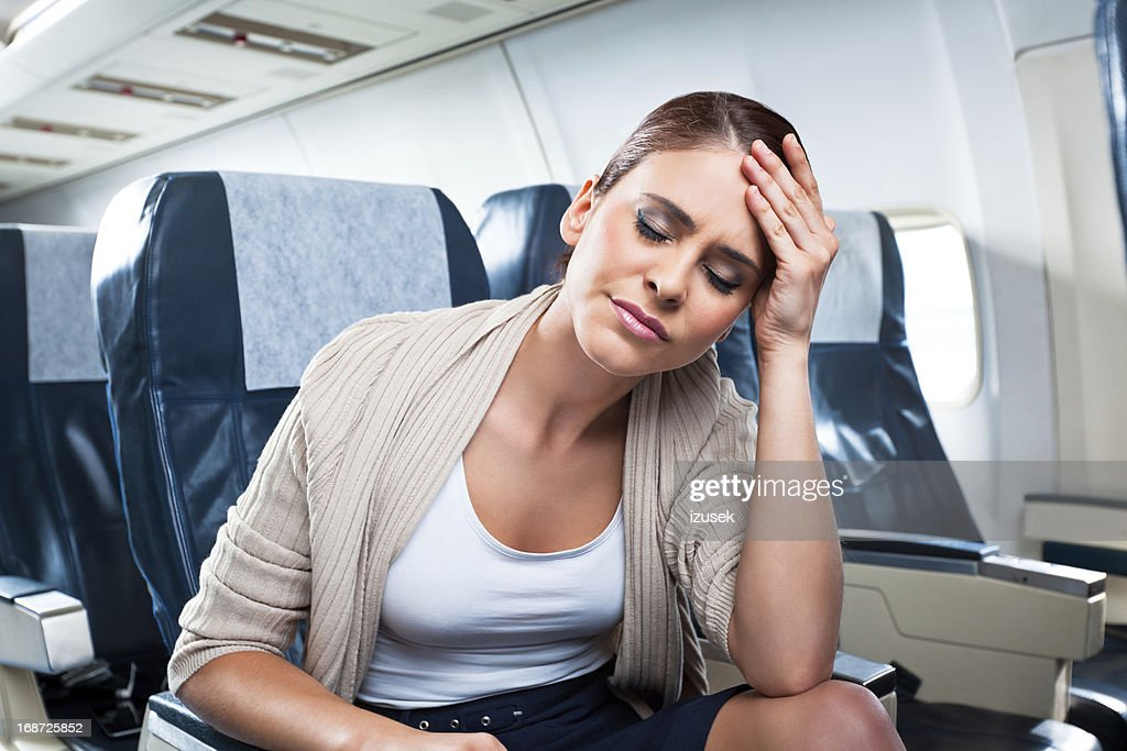 Health problem on an airplane : Stock Photo