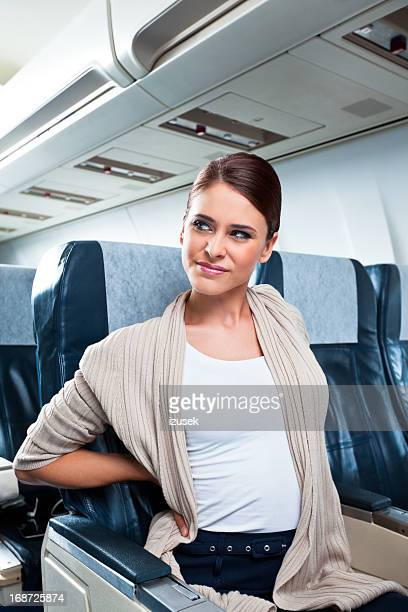 health problem on an airplane - izusek stock pictures, royalty-free photos & images