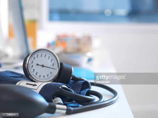 health screening, a stethoscope on a patients blood results after a a consultation - blood pressure gauge stock pictures, royalty-free photos & images