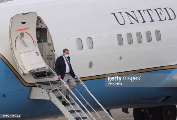 Health Secretary Alex Azar walks out of a plane as he arrives at the Sungshan Airport in Taipei on August 9, 2020. - Azar, a senior member of US...