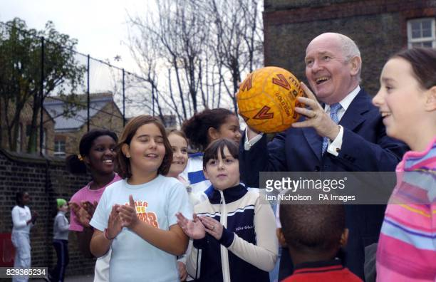 Health Secretary Dr John Reid visits a class of young pupils playing netball, at a south London school where children receive a daily ration of fruit...