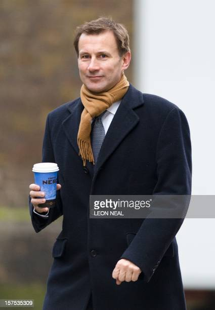 Health Secretary Jeremy Hunt arrives at number 10 Downing Street ahead of a cabinet meeting in London on December 4 2012 AFP PHOTO/Leon Neal