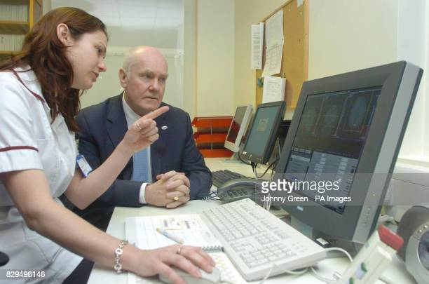 Health Secretary John Reid is shown results from tests inside the scanning facility at Newham General Hospital east London by Superintendent...