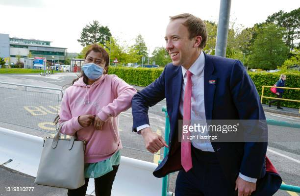Health Secretary Matt Hancock greets a member of staff with an elbow bump as he visits the Royal Cornwall Hospital on May 24, 2021 in Truro, England....