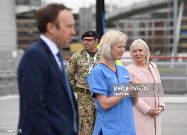Health Secretary Matt Hancock Health minister Nadine Dorries and Ruth May chief nursing officer for England attend the opening of the NHS Nightingale...