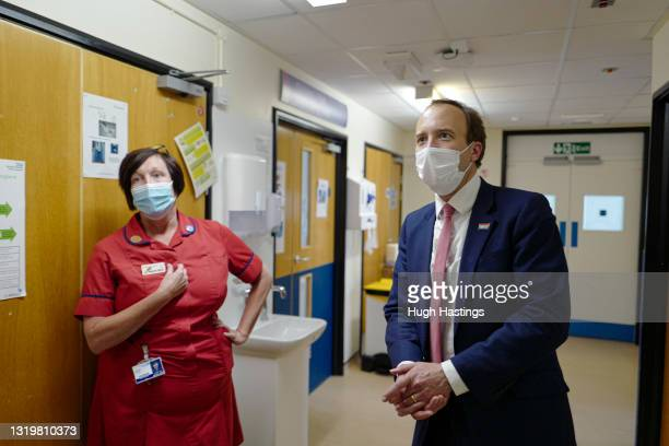 Health Secretary Matt Hancock speaks with members of staff as he visits the Royal Cornwall Hospital on May 24, 2021 in Truro, England. The Royal...