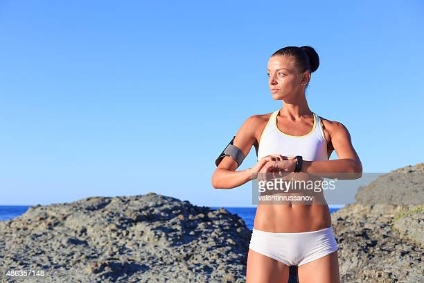 health sport woman with smart watch - wrist watch stock pictures, royalty-free photos & images