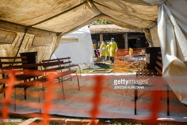 Health staff prepare a cholera treatment tent during a visit of Zimbabwe Minister of Health at the cholera treatment centre of the Beatrice...