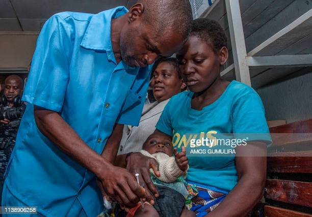 Health Surveilance Assistant gives a dose of the Malaria Vaccinne into the first recipient on April 23, 2019 at Mitundu Community hospital in...