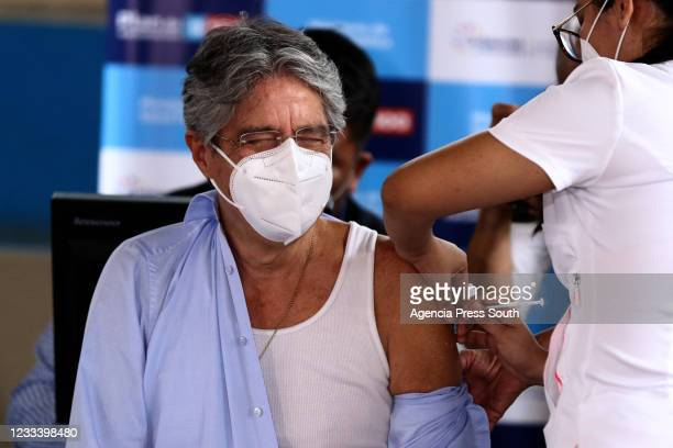 Health worker administers a dose of the Pfizer BioNTech vaccine to President of Ecuador Guillermo Lasso as part of the 9-100 vaccination campaign...