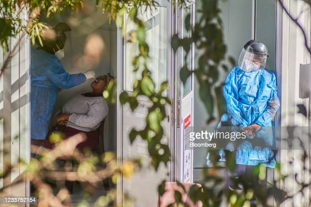 Health worker administers a nasal swab test at a Testaro Covid-19 testing site/laboratory in the Dunkeld suburb of Johannesburg, South Africa, on...