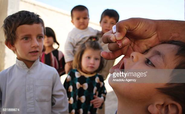A health worker administers a polio vaccine to a child out of Kabul Afghanistan on May 17 2016 Afghanistan Pakistan and Nigeria are the only three...