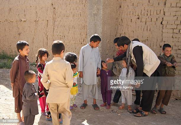 Health worker administers a polio vaccine to children, out of Kabul Afghanistan on May 17, 2016. Afghanistan, Pakistan and Nigeria are the only three...