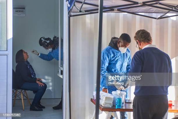 Health worker administers an oral swab test at a Testaro Covid-19 testing site/laboratory in the Dunkeld suburb of Johannesburg, South Africa, on...