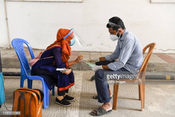 Health worker advices a patient about COVID-19 coronavirus at Mugda Medical College Hospital. Bangladesh extends nationwide lockdown measures until...