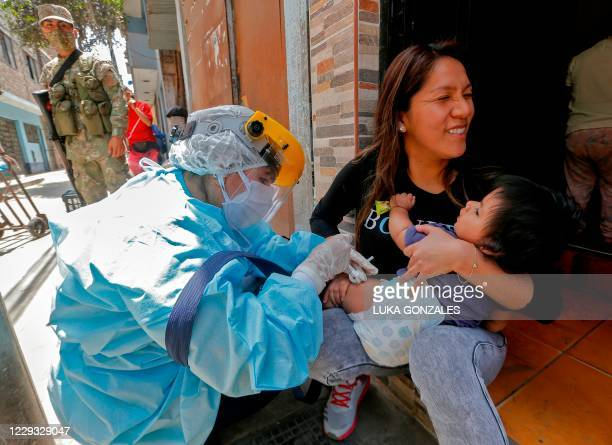 Health worker applies a vaccine against diphtheria to a baby in Lima, on October 28 after a case was detected at a popular district. - Peru has...