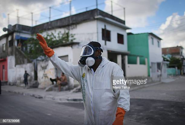 A health worker calls out to residents to remain inside during fumigation in an attempt to eradicate the mosquito which transmits the Zika virus on...