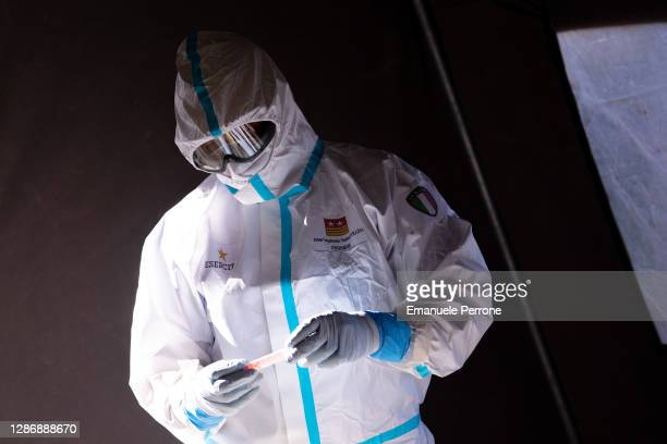 Health worker checks the tube of a swab for covid-19 during the Drive-Through-Defense in the city of Sassari on November 21, 2020 in Sassari, Italy.