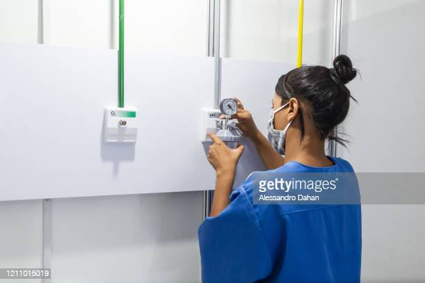 A health worker checks the valves in the LagoaBarra field hospital on April 25 2020 in Rio de Janeiro Brazil The hospital has 7 thousand square...
