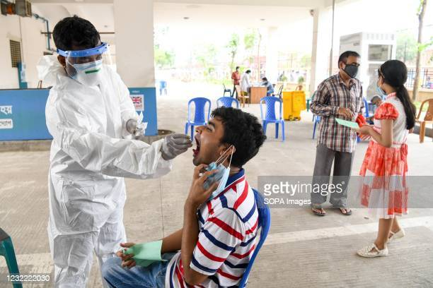 Health worker collects a swab sample from a man to test for the COVID-19 coronavirus at Mugda Medical College Hospital. Bangladesh extends nationwide...