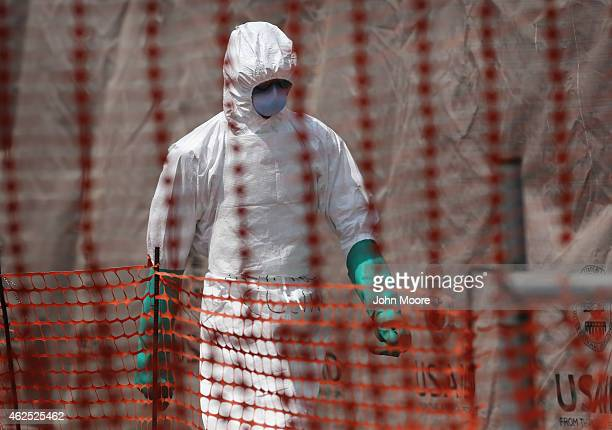 A health worker departs a highrisk section of the Ebola Treatment Unit on January 29 2015 near Tubmanburg Liberia The International Organization for...