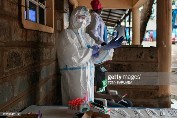 Health worker dressed in personal protective equipment prepares to test someone during a mass testing for COVID-19 coronavirus provided free of...