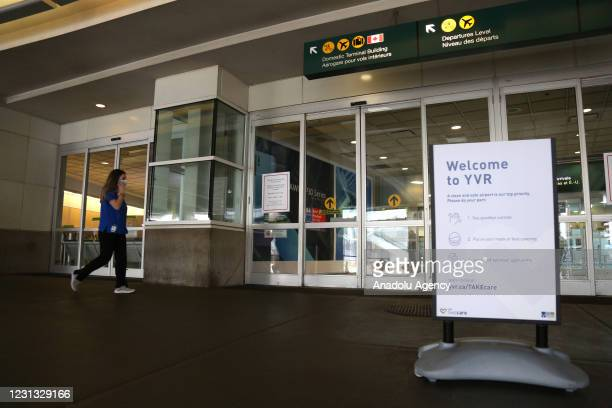 Health worker enters to COVID-19 testing area at Vancouver International Airport in Vancouver, British Columbia, Canada on February 22, 2021....