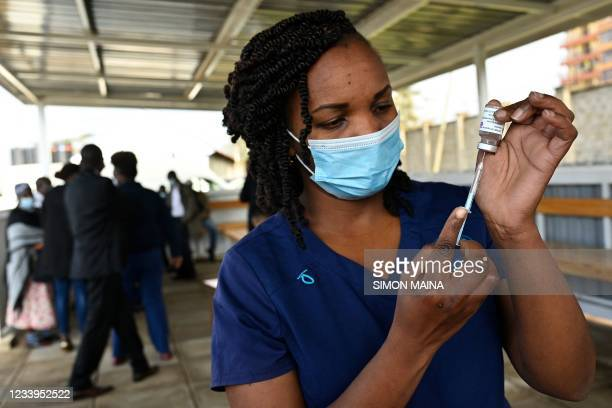 Health worker fills a syringe with a dose of the AstraZeneca/Oxford vaccine against Covid-19 at the Mbagathi hospital vaccination centre in Nairobi...