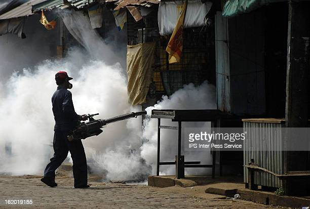 Health worker fumigates suspected mosquito breeding grounds in Colombo. Photographer: Sanka Gayashan/IPS Story Title: Finally Dengue Takes a Beating...