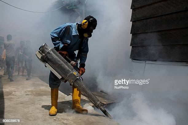 A health worker fumigation densely populated areas to prevent the spread of Aedes aegypti and possible spread of the virus Zika in Lhokseumawe Aceh...