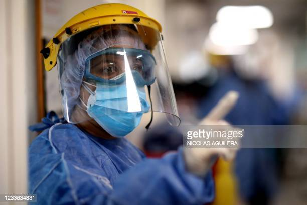 Health worker gestures during her round checking patients suffering from COVID-19 at the ICU of the San Roque Hospital in Cordoba, Argentina, on July...