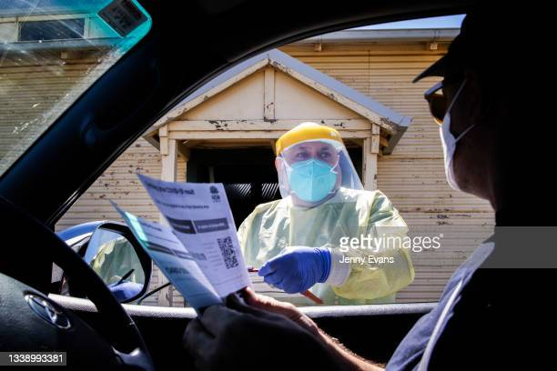 Health worker handles paperwork at a pop up COVID-19 clinic at Narromine Racecourse on September 08, 2021 in Narromine, Australia. New freedoms have...